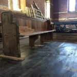 A mock up of a repaired pew